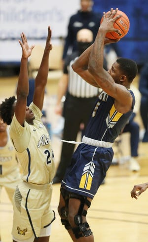Akron sophomore Ali Ali defends Kent State senior forward Danny Pippen during Friday night's game at J.A.R. Arena in Akron.