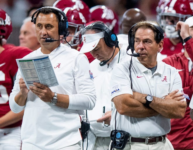 Alabama offensive coordinator Steve Sarkisian, left, and Crimson Tide head coach Nick Saban will coach one more game together: next Monday's College Football Playoff championship game. Then Sarkisian will leave to take over the Texas program.