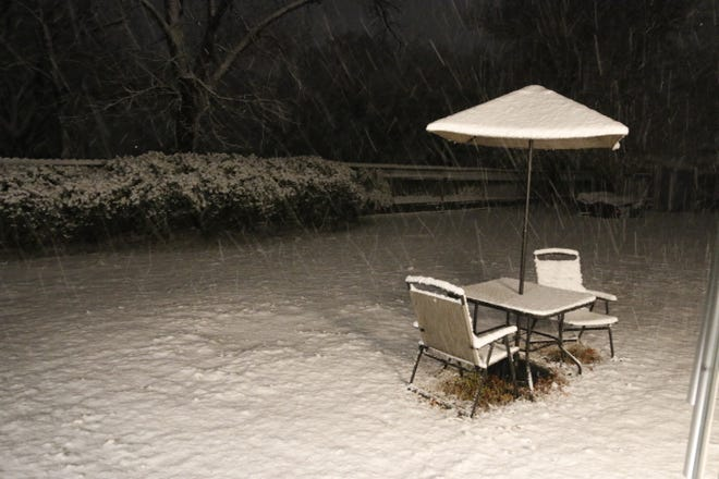Snow falls Thursday night in this photo from a south Brownwood back yard.