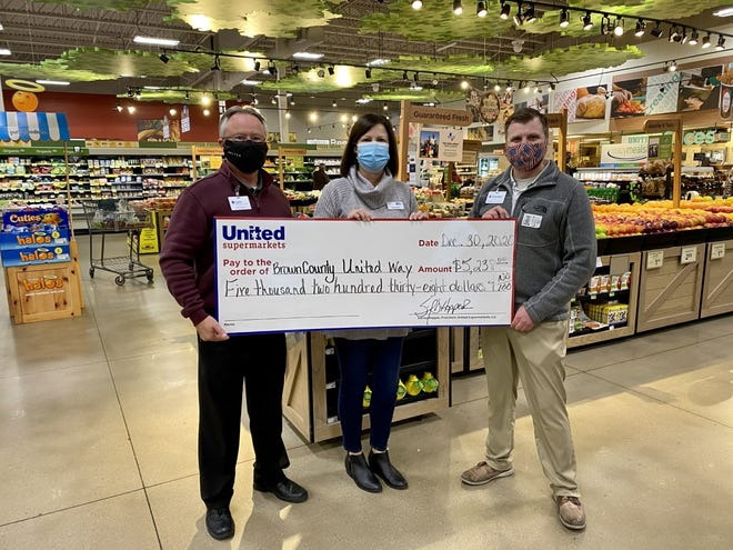 From left, United Supermarkets store manager Lynn Day, Brown County United Way Executive Director Bradlee Dodds and assistant store manager Brandon Price are pictured.