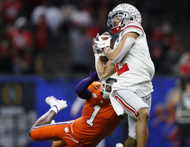 Ohio State catches a touchdown pass from Justin Fields in a College Football Playoff semifinal victory Friday.