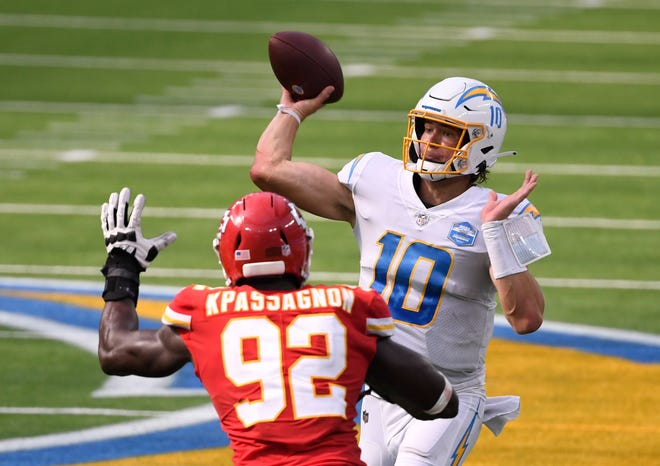 Los Angeles Chargers quarterback Justin Herbert (10) throws a pass against Kansas City Chiefs defensive end Tanoh Kpassagnon (92) during a game Sept. 20 at SoFi Stadium in Inglewood, Calif.