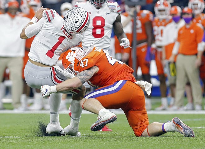 Ohio State Buckeyes quarterback Justin Fields (1) gets hit by Clemson Tigers linebacker James Skalski (47) in the second quarter during the College Football Playoff semifinal at the Allstate Sugar Bowl in the Mercedes-Benz Superdome in New Orleans on Friday, Jan. 1, 2021. Skalski was called for targeting on the play and kicked out of the game.