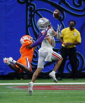 Ohio State wide receiver Chris Olave catches a 56-yard touchdown pass behind Clemson cornerback Derion Kendrick during the third quarter.