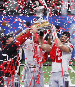 Ohio State Buckeyes coach Ryan Day, Quarterback Justin Fields and linebacker Tuf Borland hold up the Sugar Bowl Classic trophy after defeating Clemson 49-28.