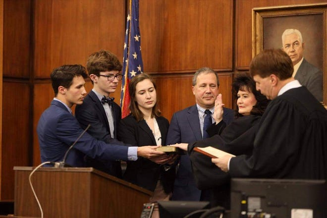 April Wood of Davidson County (second from right)  takes the oath of office for the NC Court of Appeals on Friday in Courtroom A at the Davidson County Courthouse as her family stands with her. In November, she won the election, making her the first person from Davidson County elected to the statewide position. Retired NC Supreme Court Chief Justice Mark D. Martin administered the oath.