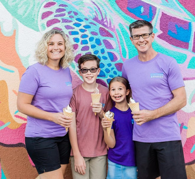 Shayla, Brady, Addie and Mark Gerling stand by the custom sea turtle mural that marks their business, Surfside Shakes, in Flagler Beach.
