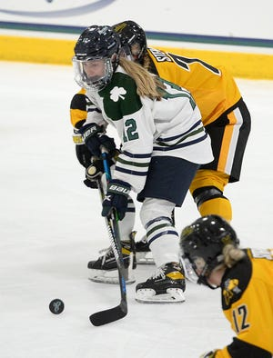 Mercyhurst's Megan Korzack brings the puck up ice against Adrian College on Saturday at the Mercyhurst Ice Center.