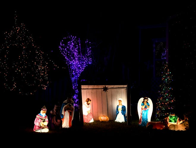 A traditional nativity scene along with trees strung with Christmas lights can be seen in this holiday display at Bancroft and Walker Streets.