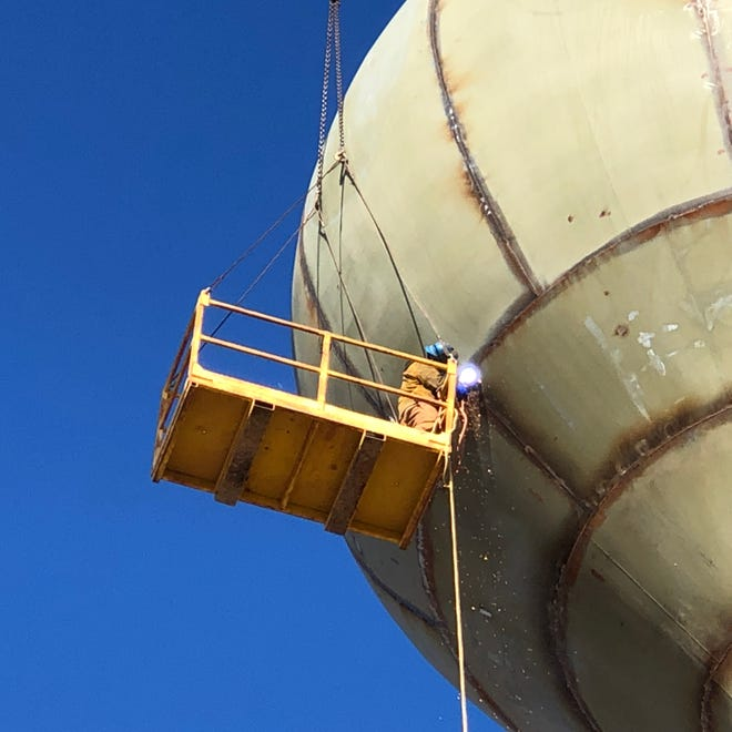 Jay Barner, an employee of Gerard Tank & Steel, of Concordia, welds the outside seams of a new water tower under construction in Victoria.
