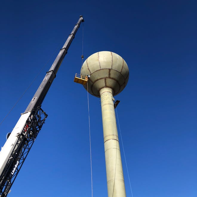 Jay Barner, an employee of Gerard Tank & Steel, of Concordia, welds the water tower under construction in Victoria.