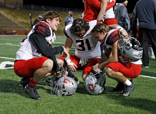 Lubbock-Cooper's Cole Foster (33), Isaiah Chavez (31) and Tyler Henson (81) kneel on the field after the Class 5A Division II region final game Friday, Jan. 1, 2021, at Dick Bivins Stadium in Amarillo, Texas.