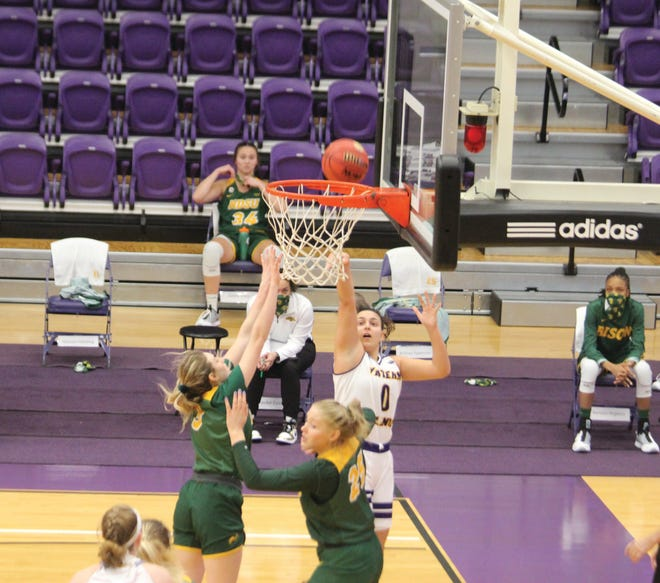 Carla Flores goes up for a basket during Saturday's game against North Dakota State.