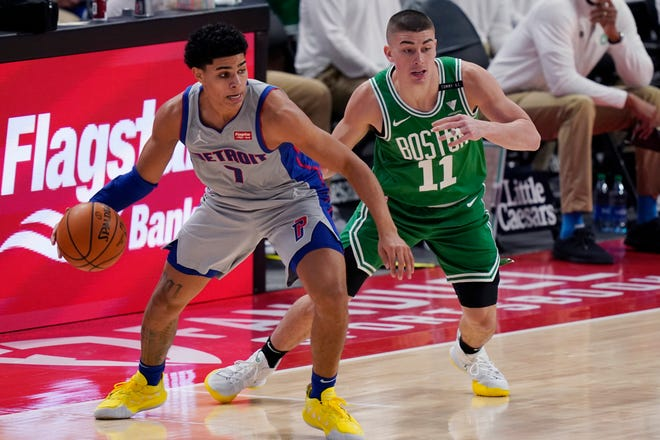 Pistons guard Killian Hayes (left) looks to pass the ball as Celtics rookie guard Payton Pritchard defends during the first half of Boston's 96-93 loss to Detroit on Friday. (AP Photo/Carlos Osorio)