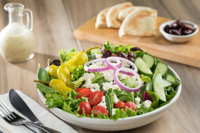 "Greek salad with pita bread is one of several items on TooJay's ""Deliciously Lite"" menu."