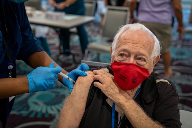 Herbert Bello, 88, receives the Moderna COVID-19 vaccine in the Kings Point clubhouse in Delray Beach on Thursday.