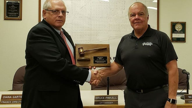 In a Pratt Tribune file photo from 2019, Doug Meyer is honored by City Manager Bruce Pinkall for his service to the city as Mayor. He stepped down from that seat last year and finished his second term as a city council member.