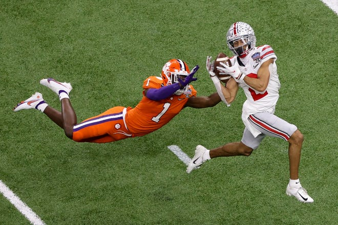 Ohio State wide receiver Chris Olave catches a touchdown pass in front of Clemson cornerback Derion Kendrick during the second half of the Sugar Bowl on Friday in New Orleans.