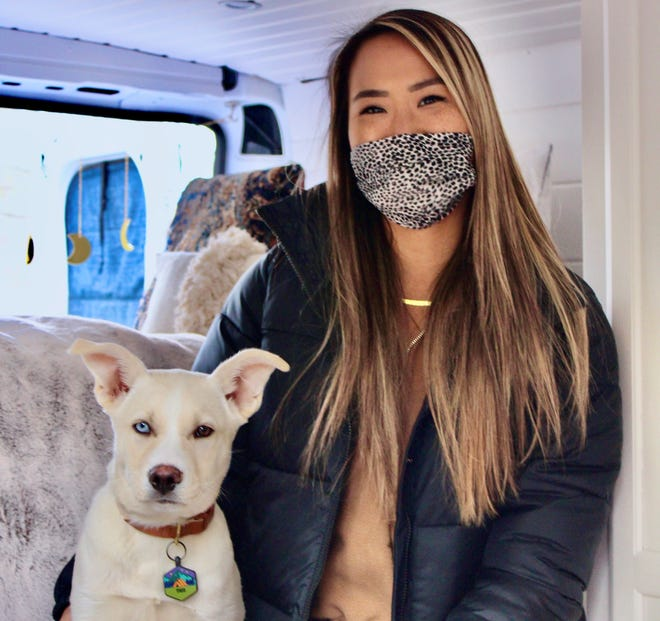 Rhode Island-based lifestyle blogger Emily Blanchard and her puppy, Theo, in the van she'll be living in for the next year.