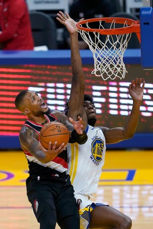 Portland's Damian Lillard, who had 34 points, drives to the basket against Golden State's James Wiseman during the Trail Blazers' 123-98 win on Friday in San Francisco.