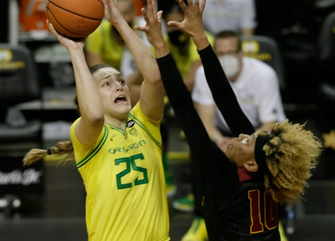 Oregon's Angela Dugalic, left, shots against USC's Amaya Oliver during the second half.