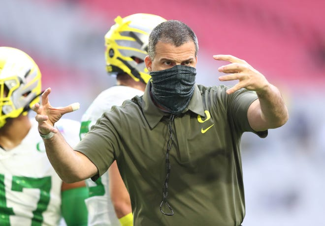 Oregon coach Mario Cristobal reacts to play against Iowa State in the first half of the Fiesta Bowl last Saturday.