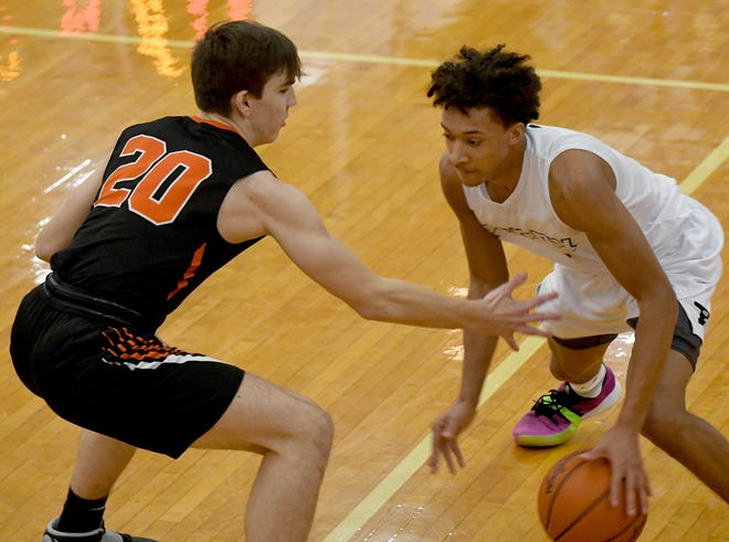 Perry's Quentin Toles dribbles past  Green's Brady Rollyson during  Green at Perry Boys Basketball.  Saturday, January 02, 2021.