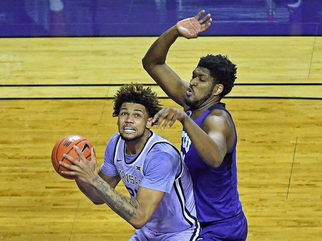 K-State's Davion Bradford (21) goes up for a shot over TCU's Kevin Samuel (21) during Saturday's game at Bramlage Coliseum in Manhattan.