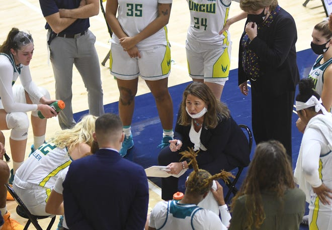 Karen Barefoot with her UNCW women's basketball team during its opening weekend of games vs. Drexel. The Seahawks have missed eight games in conference play so far because of COVID-19 protocols.