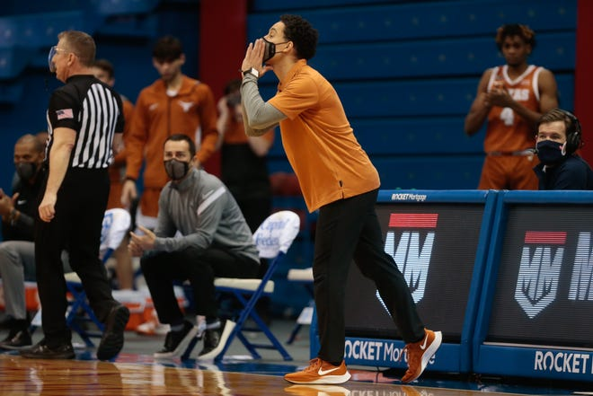 Texas coach Shaka Smart missed a week because of COVID-19 but will be back on the sideline for Tuesday's top-10 matchup with undefeated Baylor.