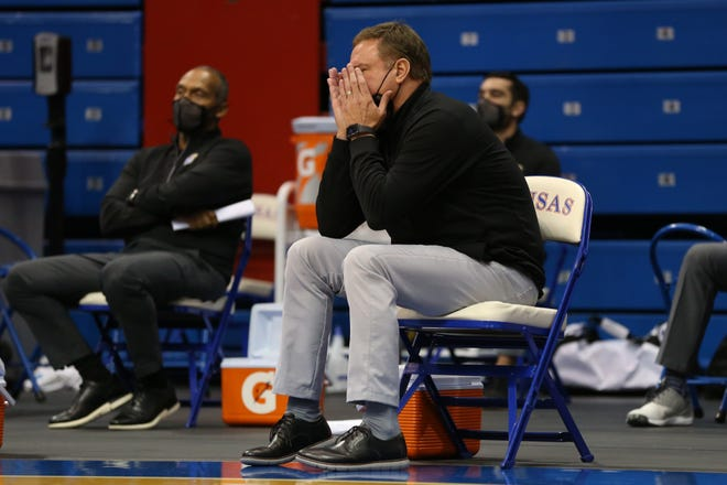 Kansas basketball coach Bill Self puts his hands over his face in the final minutes of Saturday's home game against Texas in Lawrence. The No. 3-ranked Jayhawks lost 84-59, tied for the team's most lopsided defeat in the history of Allen Fieldhouse.