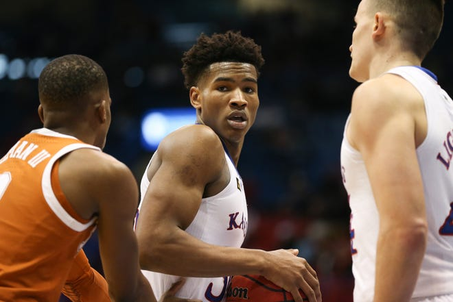 Kansas guard Ochai Agbaji reportedly will return to campus for a senior season after removing his name from the 2021 NBA Draft pool.