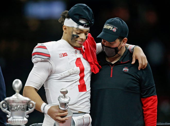 Ohio State coach Ryan Day and quarterback Justin Fields share a moment after Fields was awarded the Most Outstanding Player award in the Sugar Bowl.