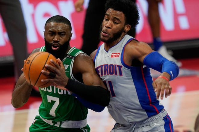 Boston's Jaylen Brown drives on Detroit's Saddiq Bey during Friday's game.