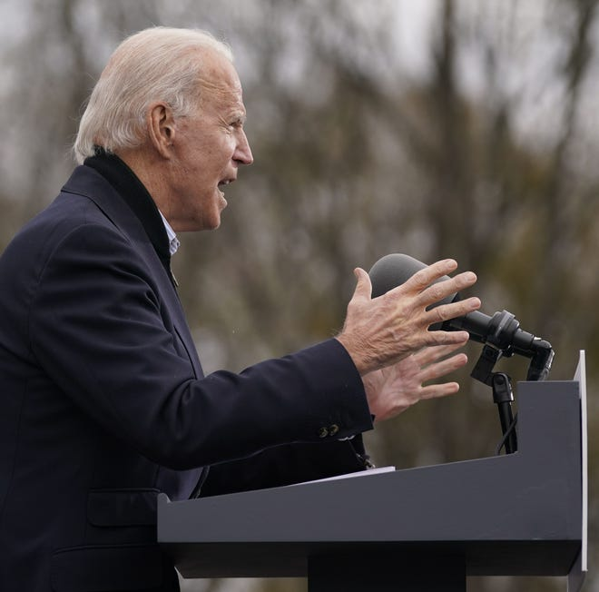 In this Dec. 15, 2020, photo, President-elect Joe Biden speaks at a drive-in rally for Georgia Democratic candidates for U.S. Senate Raphael Warnock and Jon Ossoff in Atlanta.