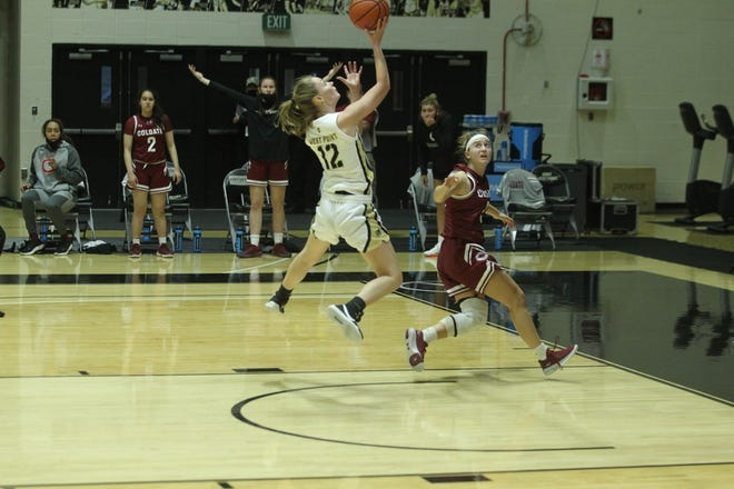 Lauren Lithgow of Army (12) goes up for a layup against Colgate University on Saturday. She led the Black Knights with 19 points. MADY SALVANI/Army Athletics