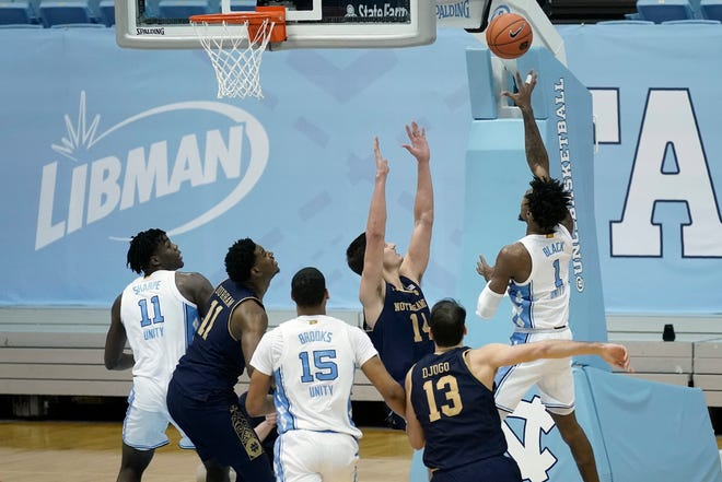 North Carolina guard Leaky Black, right, releases the game-winning shot against Notre Dame on Saturday night.