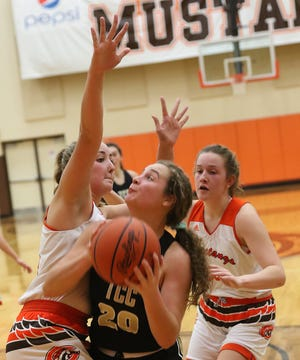 Tuscarawas Central Catholic's Sophia Knight looks for a shot over Claymont defenders Emily Grant and Raechelle Miles Saturday.