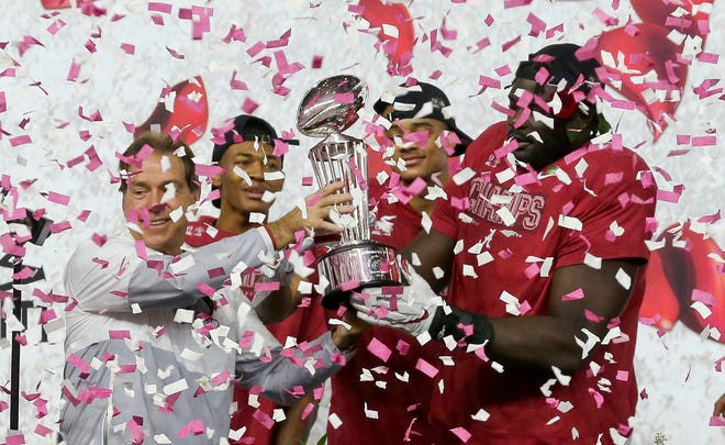 Jan 1, 2021; Arlington, TX, USA;   Coach Nick Saban and Alabama players hold the trophy amid a shower of confetti Friday, Jan. 1, 2021 following Alabama's 31-14 win over Notre Dame in the College Football Playoff Semifinal hosted by the Rose Bowl in AT&T Stadium. Mandatory Credit: Gary Cosby-USA TODAY Sports