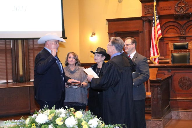 New Ellis County sheriff Brad Norman is sworn in during ceremonies held at the Ellis County Historic Courthouse on Friday, Jan. 1. Norman won a runoff in July and was unopposed in the November general election.