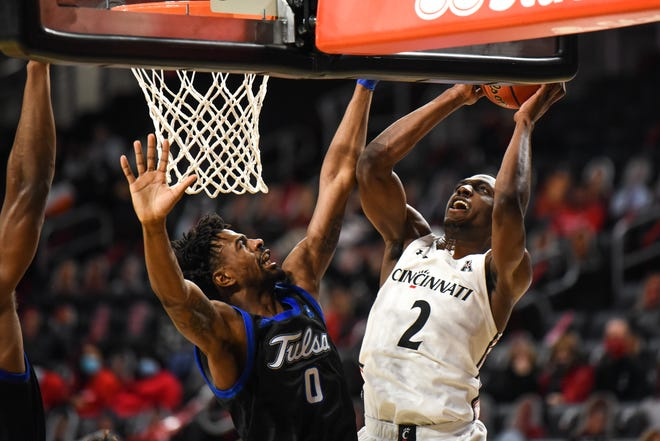 UC's Keith Williams jumps to score during the UC vs Tulsa game on Saturday January 2, 2021. Tulsa lead the game at halftime with a score of 41-33.