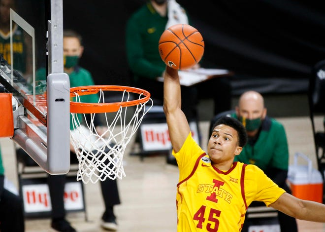 Iowa State junior guard Rasir Bolton glides in for a dunk in the first half against Baylor at Hilton Coliseum in Ames on Saturday, Dec. 2, 2021.