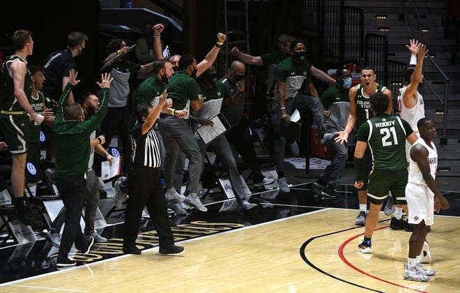 Colorado State Rams players and coaches celebrate after a three-point basket by Colorado State Rams guard John Tonje (1) against the San Diego State Aztecs during the second half at Viejas Arena on Saturday, Jan. 2, 2021.