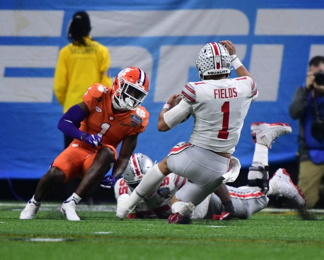 Clemson played Ohio State in the College Football Playoff Semifinal game at the Mercedes-Benz Superdome in New Orleans, LA, on Jan 1, 2021.  Ohio State quarterback Justin Fields (1) tries to get around Clemson cornerback Derion Kendrick (1) on a play.