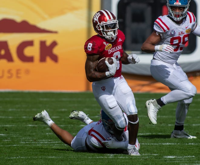 Indiana Hoosiers running back Stevie Scott III (8) gains several yards against the Mississippi Rebels in the first quarter of the Outback Bowl at Raymond James Stadium in Tampa, Florida.
