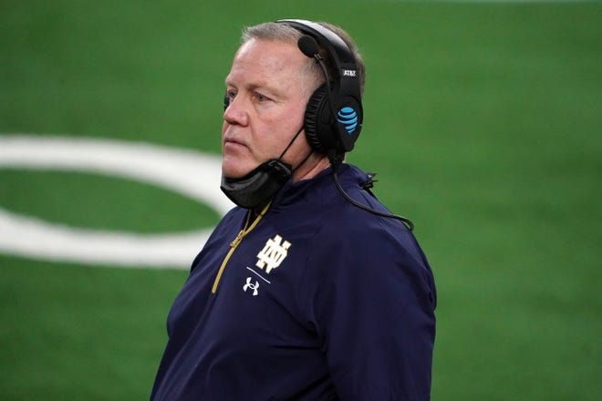 Jan 1, 2021; Arlington, TX, USA; Notre Dame Fighting Irish head coach Brian Kelly looks on in the fourth quarter against the Alabama Crimson Tide during the Rose Bowl at AT&T Stadium.