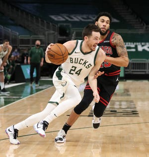 Milwaukee Bucks guard Pat Connaughton's plans for a Shorewood apartment development have received an initial village approval.