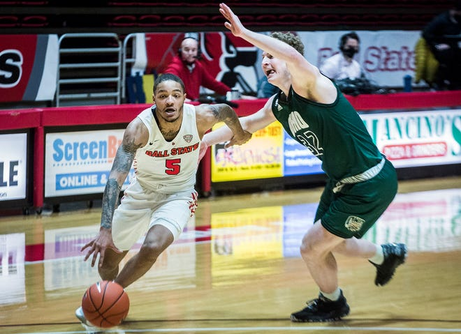 Ball State's Ishmael El-Amin slips past Ohio's defense during their game at Worthen Arena Saturday, Jan. 2, 2021.