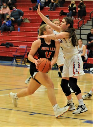 New Lex's Kim Kellogg tries to get past Lakewood's Alexa Cummins in Saturday's game. The Panthers won 60-42.