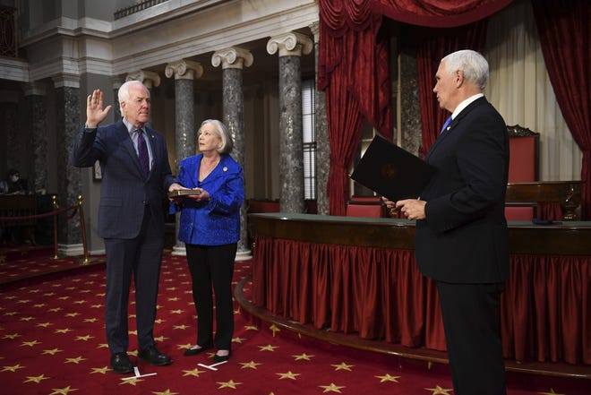 With his hand on a Bible held by wife Sandy, U.S. Sen. John Cornyn of Texas takes the oath of office, administered by Vice President Mike Pence, in a reenactment ceremony Sunday in the Old Senate Chamber at the Capitol. It was a day for many induction ceremonies, including those of seven freshman Republican U.S. representatives from Texas.